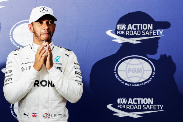 Autodromo Nazionale di Monza, Italy. Saturday 02 September 2017. Lewis Hamilton, Mercedes AMG, celebrates after taking his 69th F1 Pole Position. World Copyright: Zak Mauger/LAT Images  ref: Digital Image _56I7727