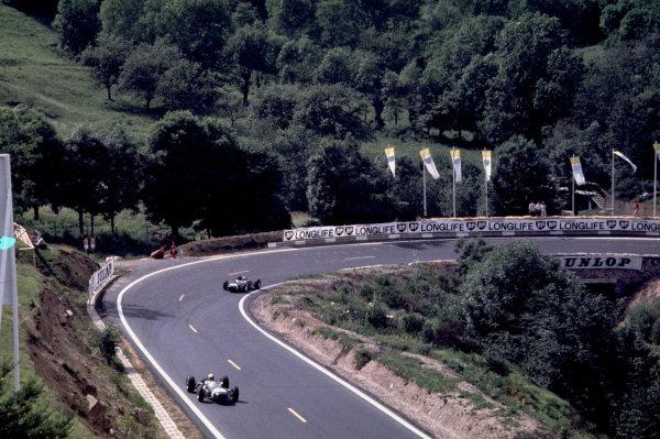 Charade, Clermont-Ferrand, France.25-27 June 1965.Jo Bonnier (Brabham BT7 Climax) leads Jo Siffert (Brabham BT11 BRM).Ref-65 FRA 03.World Copyright - LAT Photographic