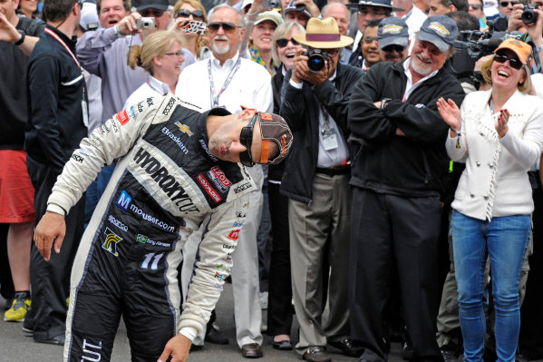 "26 May, 2013, Indianapolis, Indiana, USA Winner Tony Kanaan (#11) mugs for the cameras about kissing the ""Yard of Bricks"" without getting his famously large nose in the way. ©2013, F. Peirce Williams LAT Photo USA"
