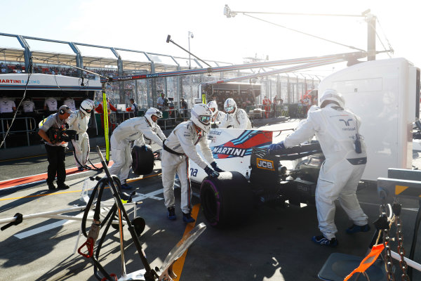 Albert Park, Melbourne, Australia. Sunday 26 March 2017. Lance Stroll, Williams FW40 Mercedes, retires from the race and is pushed into his garage by mechanics. World Copyright: Steven Tee/LAT Images ref: Digital Image _O3I3103