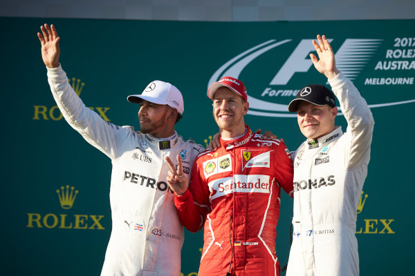 Albert Park, Melbourne, Australia. Sunday 26 March 2017. Lewis Hamilton, Mercedes AMG, 2nd Position, Sebastian Vettel, Ferrari, 1st Position, and Valtteri Bottas, Mercedes AMG, 3rd Position, on the podium. World Copyright: Steve Etherington/LAT Images ref: Digital Image SNE25438