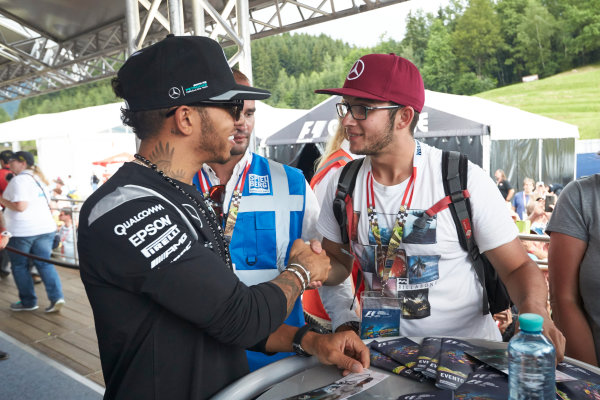 Red Bull Ring, Spielberg, Austria. Saturday 2 July 2016. Lewis Hamilton, Mercedes AMG, meets a fan. World Copyright: Steve Etherington/LAT Photographic ref: Digital Image SNE26863