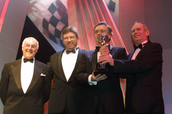 2000 Autosport Awards. Grovesnor House Hotel, Park Lane, England. 3 December 2000. Ross Brawn, Paulo Martinelli and Rory Byrne collect trophy for Racing car of the year, Ferrari F1-2000. World Copyright: Matt Jennings / LAT Photographic. Ref: Colour Transparency.