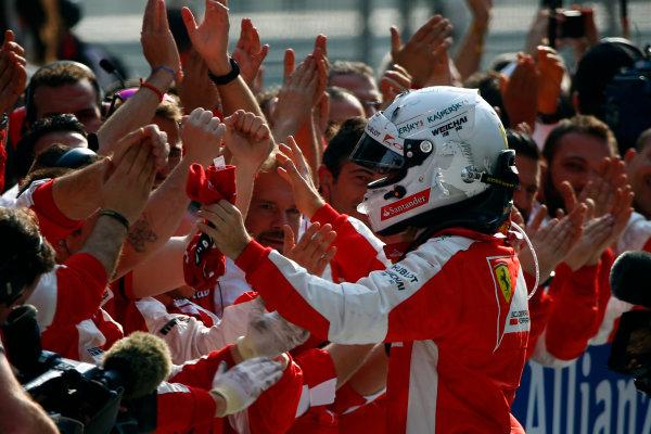 Shanghai International Circuit, Shanghai, China. Sunday 12 April 2015. Sebastian Vettel, Ferrari, 3rd Position, celebrates in Parc Ferme. World Copyright: Andrew Hone/LAT Photographic. ref: Digital Image _ONZ1152
