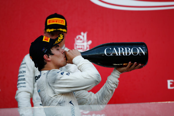 Baku City Circuit, Baku, Azerbaijan. Sunday 25 June 2017. Lance Stroll, Williams Martini Racing, drinks champagne on the podium ahead of Valtteri Bottas, Mercedes AMG.  World Copyright: Andy Hone/LAT Images ref: Digital Image _ONY9147