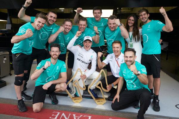 Red Bull Ring, Spielberg, Austria. Sunday 9 July 2017. Valtteri Bottas, Mercedes AMG, 1st Position, celebrates with his team. World Copyright: Steve Etherington/LAT Images ref: Digital Image SNE14792