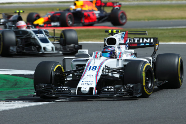 Silverstone, Northamptonshire, UK.  Sunday 16 July 2017. Lance Stroll, Williams FW40 Mercedes, leads Kevin Magnussen, Haas VF-17 Ferrari. World Copyright: Charles Coates/LAT Images  ref: Digital Image AN7T1302