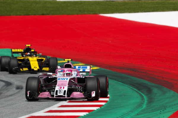 Esteban Ocon, Force India VJM11 Mercedes, leads Carlos Sainz Jr., Renault Sport F1 Team R.S. 18.
