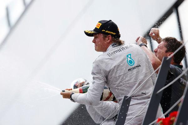 Red Bull Ring, Spielberg, Austria. Sunday 22 June 2014. Nico Rosberg, Mercedes AMG, celebrates his win on the podium. World Copyright: Charles Coates/LAT Photographic. ref: Digital Image _J5R1796