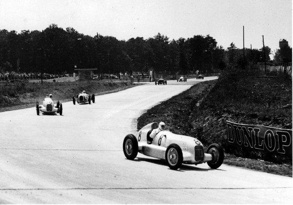 Montlhery, Paris, France. 1 July 1934. Rudolf Caracciola leads Luigi Fagioli (both Mercedes-Benz W25) and Hans Stuck (Auto Union A-typ). Ref-Autocar C4163. World Copyright - LAT Photographic