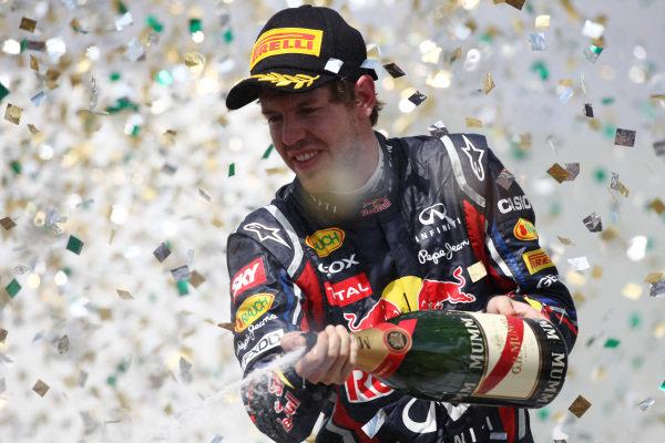 Sebastian Vettel (GER) Red Bull Racing on the podium.  Formula One World Championship, Rd 19, Brazilian Grand Prix, Race, Interlagos, Sao Paulo, Brazil, Sunday 27 November 2011.   BEST IMAGE