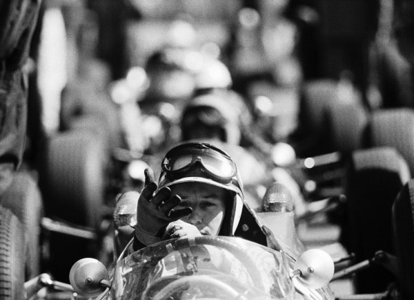 John Surtees, Ferrari 158, pulls on his gloves.