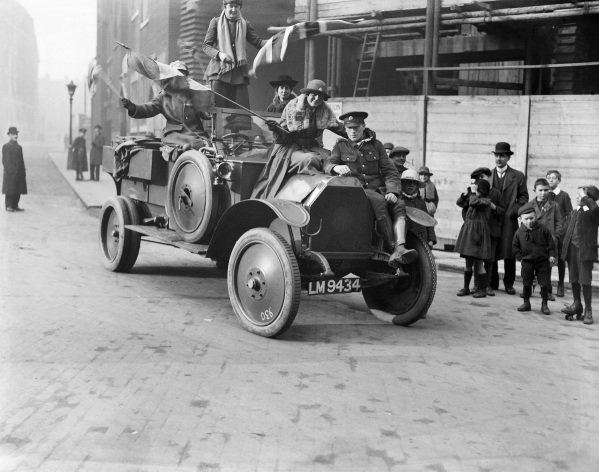 Women's Royal Air Force drivers celebrate the signing of the Armistice, in London.