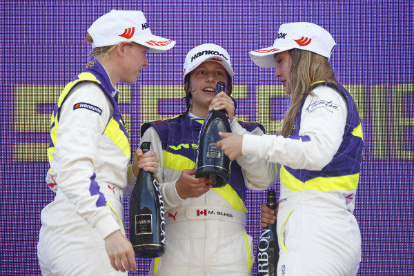Alice Powell (GBR), 3rd posistion, Megan Gilkes (CAN),1st and Sabre Cook (USA), 2nd posistion, spray champagne on the podium