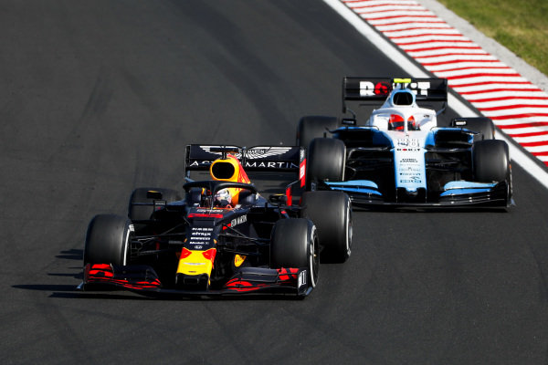 Max Verstappen, Red Bull Racing RB15, puts a lap on Robert Kubica, Williams FW42