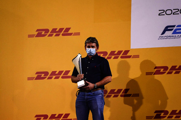 F2 Championship 2nd position Constructor Representative Andy Roche of Uni-Virtuosi celebrates on the podium with the trophy