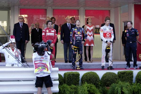 Sebastian Vettel, 1st position, Fernando Alonso, 2nd position, Jenson Button, 3rd position, and Christian Horner on the podium.