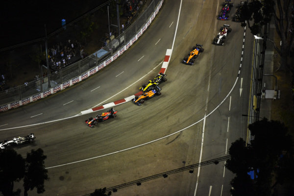 Nico Hulkenberg, Renault R.S. 19, and Carlos Sainz Jr., McLaren MCL34, make contact early in the race