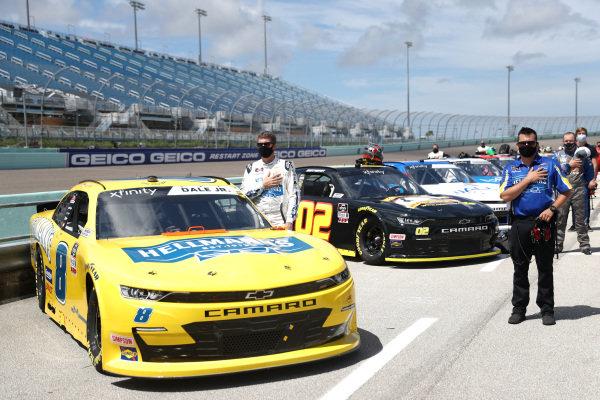 Dale Earnhardt Jr., JR Motorsports Chevrolet Hellmann's, stands for the national anthem, Copyright: Chris Graythen/Getty Images.