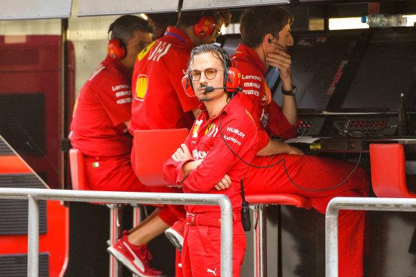 Ferrari engineer on pit wall
