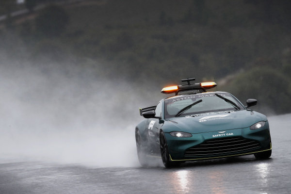 The Aston Martin Safety Car drives the track in the rain