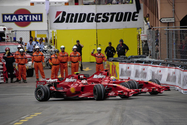 Kimi Räikkönen, Ferrari F2007 stops his car at Rascasse after sustaining damage through the Swimming Pool, blocking teammate Felipe Massa.