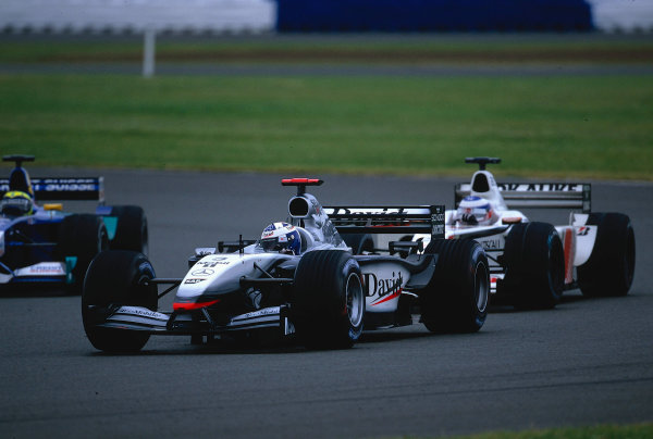 2002 British Grand Prix, Silverstone, England. 7th July 2002. David Coulthard falls back through the pack as the Bridgestone runners pass his struggling Michelin shod McLaren.World Copyright - LAT Photographic Ref: 35mm Original A12