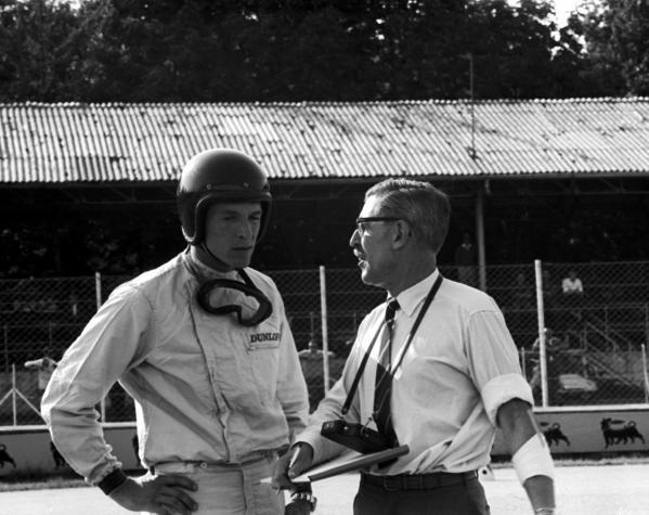 Porsche Team Manager Fritz Huschke von Hanstein (GER) (right) talks with Dan Gurney (USA) Porsche (left) who retired late in the race but was classified thirteenth. Italian Grand Prix, Monza, Italy, 16 September 1962.
