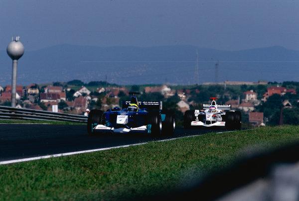 2002 Hungarian Grand Prix.Hungaroring, Budapest, Hungary. 16-18 August 2002.Felipe Massa (Sauber C21 Petronas) followed by Jacques Villeneuve (B.A R. 004 Honda). Ref-02 HUN 25.World Copyright - Tee/LAT Photographic