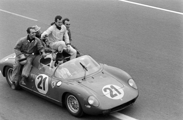Lorenzo Bandini / Ludovico Scarfiotti, Scuderia Ferrari, Ferrari 250P, conduct a victory lap with team mates.