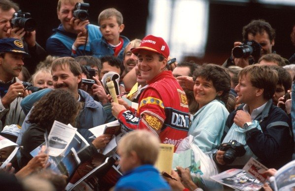 Nigel Mansell (GBR) Williams is surrounded by the British fans. British Grand Prix, Silverstone, 10 July 1988