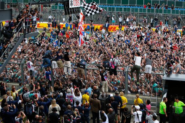 Silverstone Circuit, Northamptonshire, England. Sunday 5 July 2015. Lewis Hamilton, Mercedes AMG, 1st Position, celebrates with the fans. World Copyright: Andrew Ferraro/LAT Photographic ref: Digital Image _FER0516