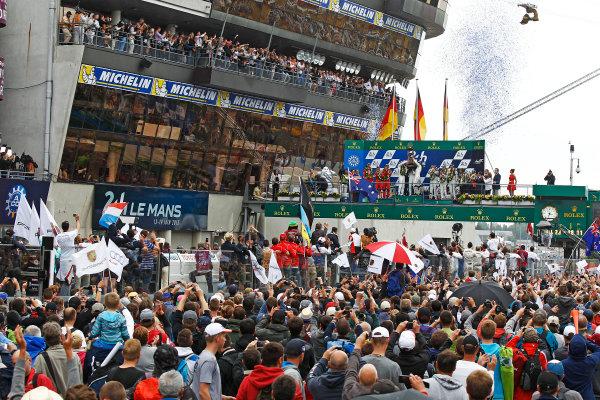 2015 Le Mans 24 Hours. Circuit de la Sarthe, Le Mans, France. Sunday 14 June 2015. Porsche Team (Porsche 919 Hybrid - LMP1), Nico Hulkenberg, Earl Bamber, Nick Tandy, Porsche Team (Porsche 919 Hybrid - LMP1), Timo Bernhard, Mark Webber, Brendon Hartley & Audi Sport Team Joest (Audi R18 E-Tron Quattro - LMP1), Marcel Fassler, Andre Lotterer, Benoit Treluyer, on the podium Photo:  Sam Bloxham/LAT Photographic. ref: Digital Image _G7C0033