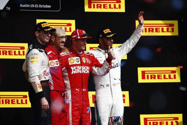 Kimi Raikkonen, Ferrari, celebrates on the podium after winning the race with Max Verstappen, Red Bull Racing, Carlos Santi, Race Engineer, Ferrari, and Lewis Hamilton, Mercedes AMG F1
