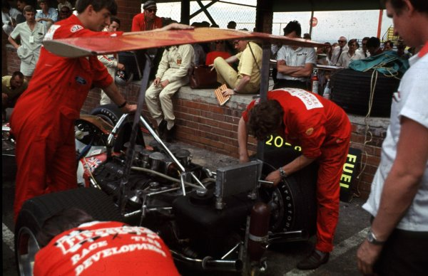 1969 South African Grand Prix.Kyalami, South Africa.27/2-1/3 1969.Mechanics fit the rear wing to a Lotus 49B Ford.Ref-69 SA 77.World Copyright - LAT Photographic