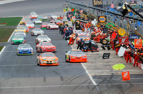 2002 NASCAR Atlanta Motor Speedway, October 25, 2002 NAPA 500/Aaron 's 312The winston cuppers racing down pit road,-Robt LeSieur2002LAT Photographic