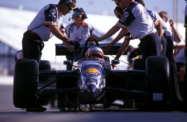 Adjustments are made to the car of Max Papis (ITA) Team Rahal in the pits.