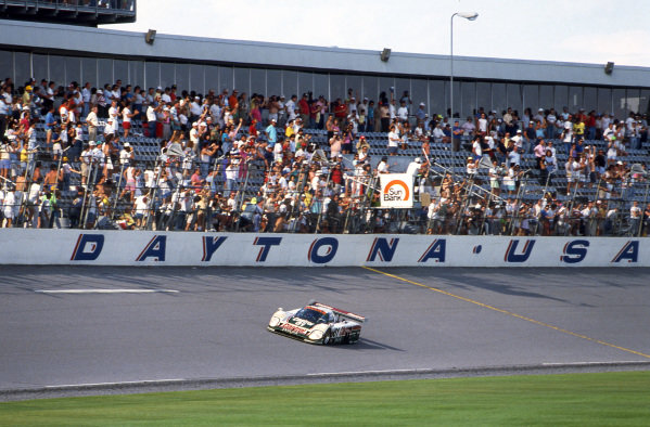 Race winners Davy Jones (USA) / Jan Lammers (NED) (driving) / Andy Wallace (GBR), Jaguar XJR-12 (Car #61, chassis #388). IMSA, Rd1, Daytona 24 Hours, Florida, USA. 3-4 February 1990.
