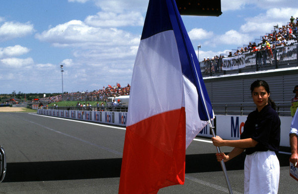 1998 French Grand Prix.Magny-Cours, Nevers, France.26-28 June 1998.A flag girl.World Copyright - LAT Photographic
