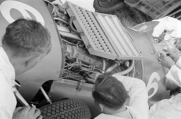 Mechanics work on Reg Parnell's BRM P15.