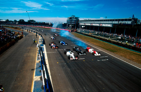 1994 British Grand Prix.Silverstone, England.8-10 July 1994.As the rest of the grid pulls away at the start Martin Brundle (McLaren MP4/9 Peugeot) goes nowhere fast because his engine had exploded in a huge fireball.Ref-94 GB 24.World Copyright - LAT Photographic
