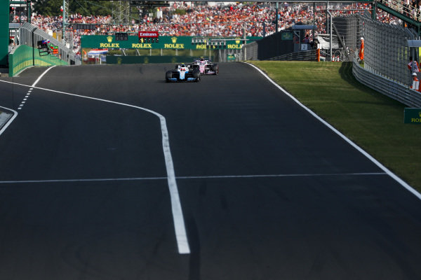 Robert Kubica, Williams FW42, leads Lance Stroll, Racing Point RP19