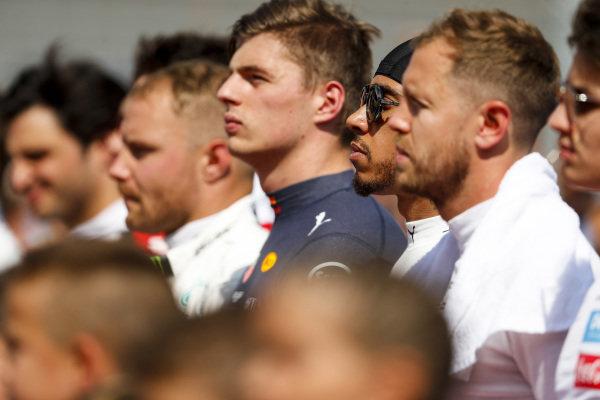 Valtteri Bottas, Mercedes AMG F1, Max Verstappen, Red Bull Racing, Sebastian Vettel, Ferrari, and the other drivers on the grid prior to the start