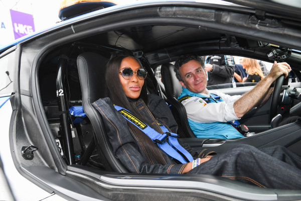 Model Naomi Campbell on a hot lap with Alejandro Agag, CEO, Formula E in the BMW i8 Safety car