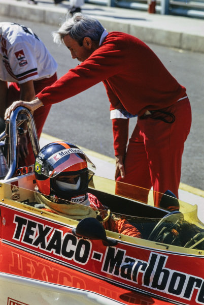 Emerson Fittipaldi and Teddy Mayer in the pits.