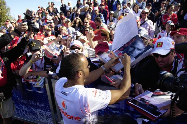 Lewis Hamilton signing autographs.