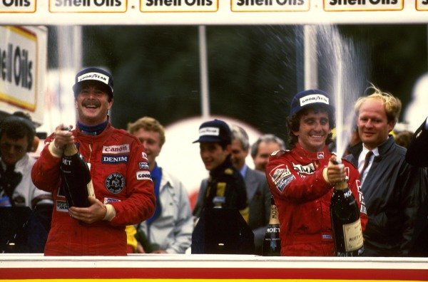 Nigel Mansell (GBR) Williams (left) celebrates his first Grand Prix Victory on the podium as Alain Prost (FRA) McLaren (right) celebrates his first World Championship after a fourth place finish. Second place Ayrton Senna (BRA) Lotus (centre) looks on in the background. Formula One World Chamnpionship, Rd14, European Grand Prix, Brands Hatch, England, 6 October 1985.