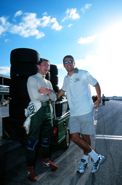 1999 CART MIAMI GP - Homestead, FL - USA 21-3-99Dario Franchitti shares some info with Indy Lights rookie Johnny Kane-1999, Michael L. Levitt / LAT Photographic