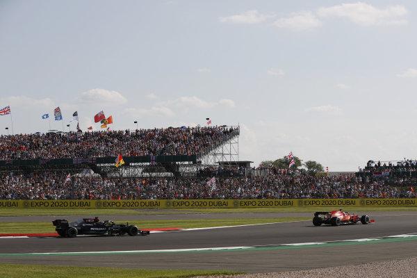 Charles Leclerc, Ferrari SF21, leads Sir Lewis Hamilton, Mercedes W12