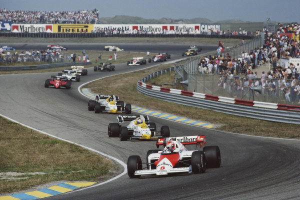 Niki Lauda, McLaren MP4-2 TAG, leads Keke Rosberg Williams FW09B Honda, Jacques Laffite Williams FW09B Honda and Michele Alboreto, Ferrari 126C4.